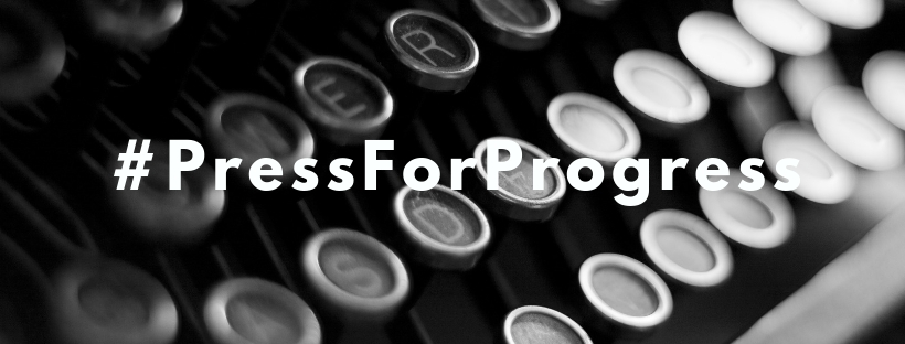 "A close up black and white image of a typewriter with the words ""#PressForProgress"" overlaid."