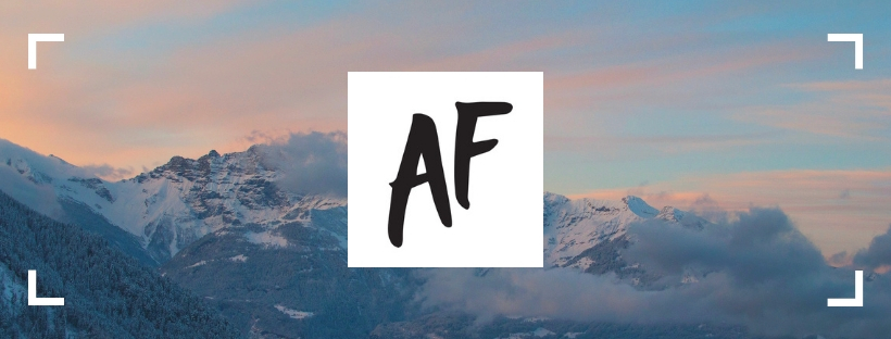 "The Attitude Foundation logo of the letters ""AF"" are in the center. The background is an image of a snowy mountain range."